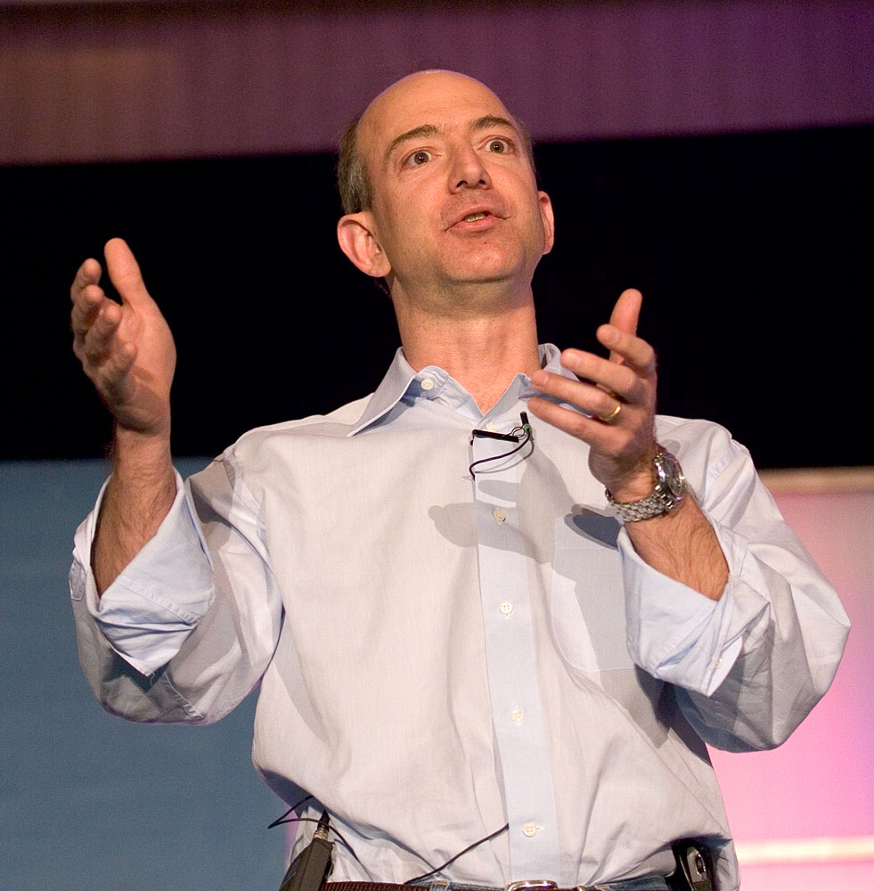 'A photograph of Jeff Bezos giving a speech, taken by James Duncan Davidson'